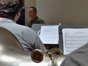Rex Martin working with a tuba student